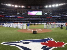 TORONTO, ON - OCTOBER 08:  The Texas Rangers and the Toronto Blue Jays stand for the national anthem prior to game one of the American League Division Series at Rogers Centre on October 8, 2015 in Toronto, Ontario, Canada.  (Photo by Tom Szczerbowski/Getty Images)