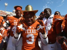 DALLAS, TX - OCTOBER 10:  Armanti Foreman #3 of the Texas Longhorns celebrates with the Golden Hat trophy after a 24-17 win against the Oklahoma Sooners during the 2015 AT&T Red River Showdown at Cotton Bowl on October 10, 2015 in Dallas, Texas.  (Photo by Ronald Martinez/Getty Images)