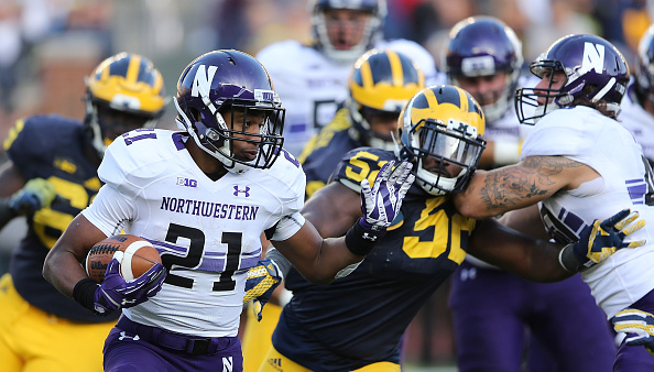 ANN ARBOR, MI - OCTOBER 10: Running back Justin Jackson #21 of the Northwestern Wildcats runs for a short gain during the first quarter of the game against the Michigan Wolverines on October 10, 2015 at Michigan Stadium in Ann Arbor, Michigan. The Wolverines defeated the Wildcats 38-0. (Photo by Leon Halip/Getty Images)