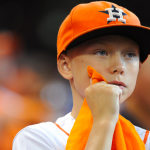 HOUSTON, TX - OCTOBER 12: A young Houston Astros fan looks on as his team loses the lead in the eighth inning against the Kansas City Royals during game four of the American League Divison Series at Minute Maid Park on October 12, 2015 in Houston, Texas. (Photo by Eric Christian Smith/Getty Images)