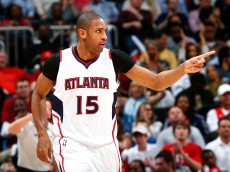 ATLANTA, GA - MARCH 30:  Al Horford #15 of the Atlanta Hawks reacts after a basket against the Milwaukee Bucks at Philips Arena on March 30, 2015 in Atlanta, Georgia.  NOTE TO USER: User expressly acknowledges and agrees that, by downloading and/or using this photograph, user is consenting to the terms and conditions of the Getty Images License Agreement.  (Photo by Kevin C. Cox/Getty Images)