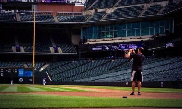 Paul Konerko on the field, snagging a picture before his final game at Coors Field. Credit: Daryl Van Schouwen