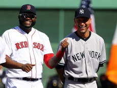 BOSTON, MA - SEPTEMBER 28: Derek Jeter #2 of the New York Yankees speaks with David Ortiz #34 of the Boston Red Sox prior to the last game of the season at Fenway Park on September 28, 2014 in Boston, Massachusetts.  (Photo by Al Bello/Getty Images)