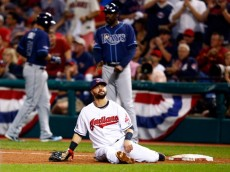 CLEVELAND, OH - OCTOBER 02:  Nick Swisher #33 of the Cleveland Indians sits on the ground after doing a split to make a double play against the Tampa Bay Rays during the American League Wild Card game at Progressive Field on October 2, 2013 in Cleveland, Ohio.  (Photo by Jared Wickerham/Getty Images)