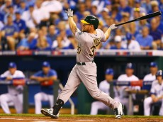 KANSAS CITY, MO - SEPTEMBER 30:  Brandon Moss #37 of the Oakland Athletics hits a two-run home run in the first inning against the Kansas City Royals during the American League Wild Card game at Kauffman Stadium on September 30, 2014 in Kansas City, Missouri.  (Photo by Dilip Vishwanat/Getty Images)