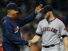 DETROIT, MI - JULY 18:  Pitcher Cody Allen #37 of the Cleveland Indians is congratulated by manager Terry Francona #17 after a 9-3 win over the Detroit Tigers at Comerica Park on July 18, 2014 in Detroit, Michigan. (Photo by Duane Burleson/Getty Images)