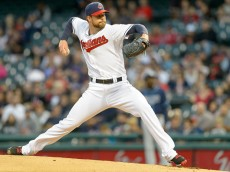 CLEVELAND, OH - SEPTEMBER 26: Starting pitcher Corey Kluber #28 of the Cleveland Indians pitches during the first inning against the Tampa Bay Rays at Progressive Field on September 26, 2014 in Cleveland, Ohio. (Photo by Jason Miller/Getty Images)