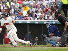 CLEVELAND, OH - SEPTEMBER 28:  Tyler Holt #62 of the Cleveland Indians hits a double against the Tampa Bay Rays during the fifth inning of their game on September 28, 2014 at Progressive Field in Cleveland, Ohio.  The Indians defeated the Rays 7-2. (Photo by David Maxwell/Getty Images)