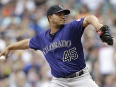 MILWAUKEE, WI - JUNE 28: Jhoulys Chacin #45 of the Colorado Rockies pitches during the first inning against the Milwaukee Brewers at Miller Park on June 28, 2014 in Milwaukee, Wisconsin. (Photo by Mike McGinnis/Getty Images)
