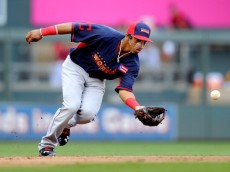 MINNEAPOLIS, MN - JULY 13:  Francisco Lindor of the World Team fields a ball against the U.S. Team during the SiriusXM All-Star Futures Game at Target Field on July 13, 2014 in Minneapolis, Minnesota.  (Photo by Hannah Foslien/Getty Images)