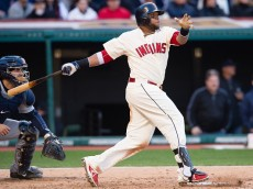CLEVELAND, OH - APRIL 10: Carlos Santana #41 of the Cleveland Indians hits an RBI single during the sixth inning against the Detroit Tigers during the home opener at Progressive Field on April 10, 2015 in Cleveland, Ohio.(Photo by Jason Miller/Getty Images)