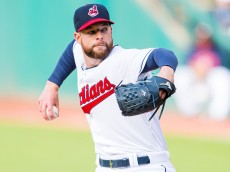 CLEVELAND, OH -  APRIL 27: Starting pitcher Corey Kluber #28 of the Cleveland Indians pitches during the first inning against the Kansas City Royals at Progressive Field on April 27, 2015 in Cleveland, Ohio. (Photo by Jason Miller/Getty Images)  *** Local Caption *** Corey Kluber