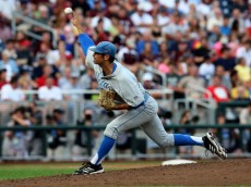 OMAHA, NE - JUNE 24:  Adam Plutko #9 of the UCLA Bruins throws a pitch against the Mississippi State Bulldogs during game one of the College World Series Finals on June 24, 2013 at TD Ameritrade Park in Omaha, Nebraska.  UCLA won 3-1.  (Photo by Stephen Dunn/Getty Images)