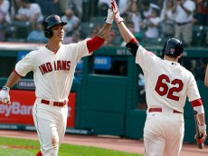 CLEVELAND, OH - SEPTEMBER 28:  Zach Walters #6 of the Cleveland Indians celebrates with Tyler Holt #62 after hitting a home run against the Tampa Bay Rays during the second inning of their game on September 28, 2014 at Progressive Field in Cleveland, Ohio.  The Indians defeated the Rays 7-2. (Photo by David Maxwell/Getty Images)
