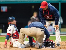 CLEVELAND, OH - APRIL 11: Catcher Yan Gomes #10 is examined by a trainer and Manager Terry Francona #17 of the Cleveland Indians after Gomes suffered an injury during the ninth inning against the Detroit Tigers at Progressive Field on April 11, 2015 in Cleveland, Ohio.(Photo by Jason Miller/Getty Images)  *** Local Caption *** Yan Gomes; Terry Francona