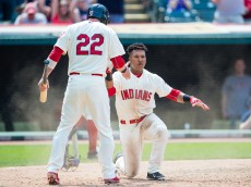 CLEVELAND, OH -  MAY 3: Jason Kipnis #22 celebrates with Jose Ramirez #11 of the Cleveland Indians after both scored to tie the game during the fifth inning against the Toronto Blue Jays at Progressive Field on May 3, 2015 in Cleveland, Ohio. (Photo by Jason Miller/Getty Images)