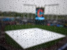 KANSAS CITY, MO - MAY 7:  Rain drops roll the   Kauffman Stadium press box window during a rain delay between the Cleveland Indians and Kansas City Royals on May 7, 2015 in Kansas City, Missouri. (Photo by Ed Zurga/Getty Images)