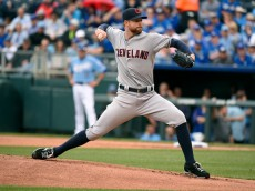 KANSAS CITY, MO - MAY 7:  Corey Kluber #28 of the Cleveland Indians throws in the first inning during a game against the Kansas City Royals at Kauffman Stadium on May 7, 2015 in Kansas City, Missouri. (Photo by Ed Zurga/Getty Images)