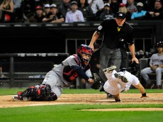 CHICAGO, IL - MAY 18: Adam Eaton #1 of the Chicago White Sox scores on a wild pitch as Roberto Perez #55 of the Cleveland Indians tries to tag him during the sixth inning on May 18, 2015 at U. S. Cellular Field in Chicago, Illinois.  (Photo by David Banks/Getty Images)