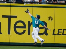 SEATTLE, WA - MAY 29:  Left fielder Dustin Ackley #13 of the Seattle Mariners makes a running catch of a deep fly ball off the bat of Michael Brantley of the Cleveland Indians  in the seventh inning at Safeco Field on May 29, 2015 in Seattle, Washington.  (Photo by Otto Greule Jr/Getty Images)