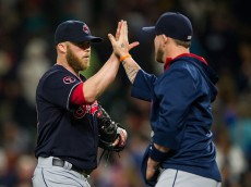 SEATTLE, WA - MAY 30:  Pitcher Cody Allen #37 of the Cleveland Indians is congratulated by a teammate after getting the save against the Seattle Mariners during MLB baseball action at Safeco Field on May 30, 2015 in Seattle, Washington.  (Photo by Rich Lam/Getty Images)