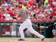 CINCINNATI, OH - JUNE 6: Todd Frazier #21 of the Cincinnati Reds doubles to center field to drive in two runs in the first inning of the game against the San Diego Padres at Great American Ball Park on June 6, 2015 in Cincinnati, Ohio. (Photo by Joe Robbins/Getty Images)