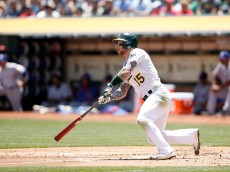 OAKLAND, CA - JUNE 11:  Brett Lawrie #15 of the Oakland Athletics bats against the Texas Rangers at O.co Coliseum on June 11, 2015 in Oakland, California.  (Photo by Ezra Shaw/Getty Images)