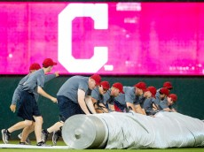 CLEVELAND, OH -  JUNE 18: The Cleveland Indians grounds crew rolls out the tarp for a rain delay during the top of the fifth inning against the Chicago Cubs at Progressive Field on June 18, 2015 in Cleveland, Ohio.  (Photo by Jason Miller/Getty Images)