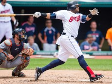 CLEVELAND, OH -  JUNE 24: Carlos Santana #41 of the Cleveland Indians hits a two RBI double during the third inning against the Detroit Tigers at Progressive Field on June 24, 2015 in Cleveland, Ohio. (Photo by Jason Miller/Getty Images)