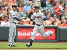 BALTIMORE, MD - JUNE 26:  Brandon Moss #44 of the Cleveland Indians celebrates a solo home run the second inning with third base coach Mike Sarbaugh #16 during a baseball game against the Baltimore Orioles at Oriole Park at Camden Yards on June 26, 2015 in Baltimore, Maryland.  (Photo by Mitchell Layton/Getty Images)