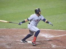 BALTIMORE, MD - JUNE 26:  Carlos Santana #41 of the Cleveland Indians hits a solo home run in the with inning during a baseball game against the Baltimore Orioles at Oriole Park at Camden Yards on June 26, 2015 in Baltimore, Maryland.  The Orioles won 4-3.  (Photo by Mitchell Layton/Getty Images)