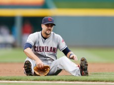 CINCINNATI, OH - AUGUST 7: Lonnie Chisenhall #8 of the Cleveland Indians reacts after a throwing error on first baseman Carlos Santana allowed Billy Hamilton of the Cincinnati Reds to score a run in the first inning of the game at Great American Ball Park on August 7, 2014 in Cincinnati, Ohio. (Photo by Joe Robbins/Getty Images)