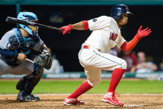 CLEVELAND, OH -  JUNE 20: Francisco Lindor #12 of the Cleveland Indians hits an RBI single during the eighth inning against the Tampa Bay Rays at Progressive Field on June 20, 2015 in Cleveland, Ohio.  (Photo by Jason Miller/Getty Images)