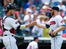 CLEVELAND, OH -  JUNE 24: Catcher Yan Gomes #10 of the Cleveland Indians celebrates with Relief pitcher Cody Allen #37 of the Cleveland Indians after the Indians defeated the Detroit Tigers at Progressive Field on June 24, 2015 in Cleveland, Ohio. The Indians defeated the Tigers 8-2. (Photo by Jason Miller/Getty Images)  *** Local Caption *** Yan Gomes; Cody Allen