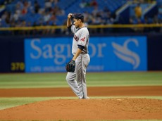 ST. PETERSBURG, FL - JULY 1:  Pitcher Carlos Carrasco #59 of the Cleveland Indians prepares to pitch at the start of the bottom of the eighth inning of a game against the Tampa Bay Rays on July 1, 2015 at Tropicana Field in St. Petersburg, Florida.  (Photo by Brian Blanco/Getty Images)