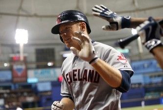 ST. PETERSBURG, FL - JULY 1:  Brandon Moss #44 of the Cleveland Indians celebrates as he makes his way back to the dugout after hitting a three-run home run during the eighth inning of a game against the Tampa Bay Rays on July 1, 2015 at Tropicana Field in St. Petersburg, Florida.  (Photo by Brian Blanco/Getty Images) *** Local Caption *** Brandon Moss