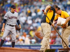 PITTSBURGH, PA - JULY 03:  Trevor Bauer #47 of the Cleveland Indians looks on at the grounds crew works on the pitchers mound in the third inning against the Pittsburgh Pirates during the interleague game at PNC Park on July 3, 2015 in Pittsburgh, Pennsylvania.  (Photo by Jared Wickerham/Getty Images)
