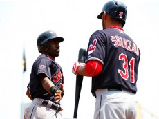 PITTSBURGH, PA - JULY 05: Michael Bourn #24 of the Cleveland Indians is congratulated by teammate Danny Salazar #31 after scoring in the first inning against  the Pittsburgh Pirates during the game at PNC Park on July 5, 2015 in Pittsburgh, Pennsylvania.  (Photo by Jared Wickerham/Getty Images)