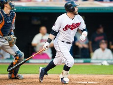 CLEVELAND, OH -  JULY 6: Jason Kipnis #22 of the Cleveland Indians hits an RBI sacrifice fly to left during the third inning against the Houston Astros at Progressive Field on July 6, 2015 in Cleveland, Ohio. (Photo by Jason Miller/Getty Images)