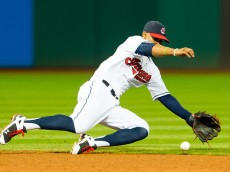 CLEVELAND, OH -  JULY 7: Shortstop Francisco Lindor #12 of the Cleveland Indians fields a ground ball hit by Carlos Correa #1 of the Houston Astros during the sixth inning at Progressive Field on July 7, 2015 in Cleveland, Ohio. (Photo by Jason Miller/Getty Images)