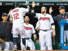 CLEVELAND, OH -  JULY 9: Manager Terry Francona #17 Mike Aviles #4 and Jason Kipnis #22 celebrate with Francisco Lindor #12 of the Cleveland Indians after Lindor hit a solo home run during the sixth inning at Progressive Field on July 9, 2015 in Cleveland, Ohio.  (Photo by Jason Miller/Getty Images)  *** Local Caption *** Terry Francona; Mike Aviles; Jason Kipnis; Francisco Lindor