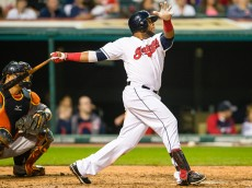 CLEVELAND, OH -  JULY 9: Carlos Santana #41 of the Cleveland Indians hits an RBI triple during the sixth inning against the Houston Astros at Progressive Field on July 9, 2015 in Cleveland, Ohio.  (Photo by Jason Miller/Getty Images)