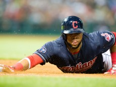 CLEVELAND, OH -  JULY 10: Carlos Santana #41 of the Cleveland Indians dives back to first base during the seventh inning against the Oakland Athletics at Progressive Field on July 10, 2015 in Cleveland, Ohio. (Photo by Jason Miller/Getty Images)