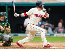 CLEVELAND, OH -  JULY 11: Jason Kipnis #22 of the Cleveland Indians hits a triple to left during the sixth inning against the Oakland Athletics at Progressive Field on July 11, 2015 in Cleveland, Ohio. (Photo by Jason Miller/Getty Images)  *** Local Caption *** Jason Kipnis