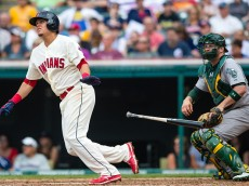 CLEVELAND, OH -  JULY 12:  Giovanny Urshela #39 of the Cleveland Indians hits a single in the eighth inning against the Oakland Athletics at Progressive Field on July 12, 2015 in Cleveland, Ohio. (Photo by Jason Miller/Getty Images)