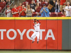 CINCINNATI, OH - JULY 17: Billy Hamilton #6 of the Cincinnati Reds catches a fly ball near the center field wall in the fourth inning against the Cleveland Indians at Great American Ball Park on July 17, 2015 in Cincinnati, Ohio. (Photo by Joe Robbins/Getty Images)