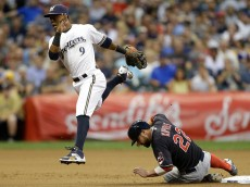 MILWAUKEE, WI - JULY 21: Jean Segura #9 of the Milwaukee Brewers jumps over Jason Kipnis #22 of the Cleveland Indians while turning the double play during the fifth inning of the Interleague game at Miller Park on July 21, 2015 in Milwaukee, Wisconsin. (Photo by Mike McGinnis/Getty Images)