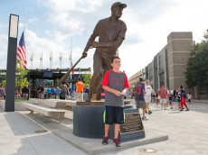CLEVELAND, OH -  JULY 25: Cleveland Indians fan Nick Putnam, 8, of San Diego poses for a photo with a new statue honoring Indians great Larry Doby outside the gates at Progressive Field prior to the game between the Cleveland Indians and the Chicago White Sox on July 25, 2015 in Cleveland, Ohio. Doby was the second African American to play in the major leagues and the first in the American League when he was hired by the Indians on July 5, 1947.(Photo by Jason Miller/Getty Images)
