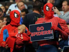 "DENVER, CO - MARCH 19:  Fans of the Richmond Spiders dressed as Spiderman hold up a sign reading ""Go Spiders"" during a game against the Morehead State Eagles in the third round of the 2011 NCAA men's basketball tournament at Pepsi Center on March 19, 2011 in Denver, Colorado.  (Photo by Doug Pensinger/Getty Images)"