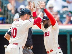 CLEVELAND, OH - AUGUST 9: Yan Gomes #10 of the Cleveland Indians celebrates with Abraham Almonte #35 of the Cleveland Indians after Almonte hit a two run home run during the third inning against the Minnesota Twins at Progressive Field on August 9, 2015 in Cleveland, Ohio. (Photo by Jason Miller/Getty Images)  *** Local Caption *** Yan Gomes; Abraham Almonte